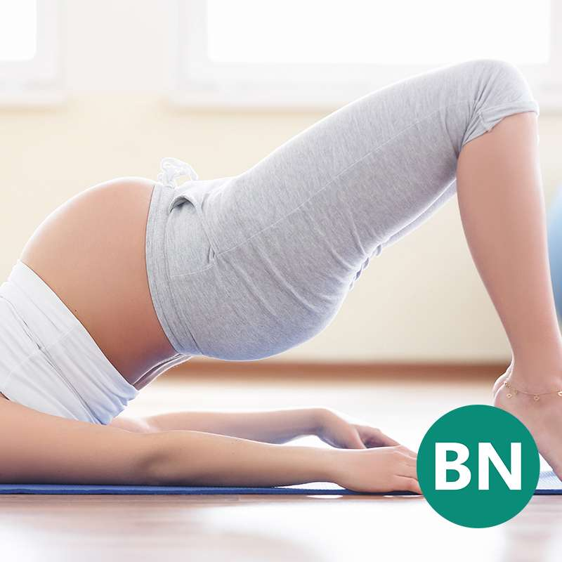 Woman who has sciatica during pregnancy stretching