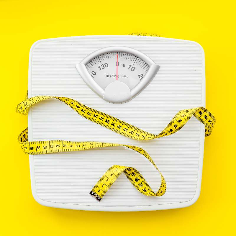 Weight scale with measuring tape