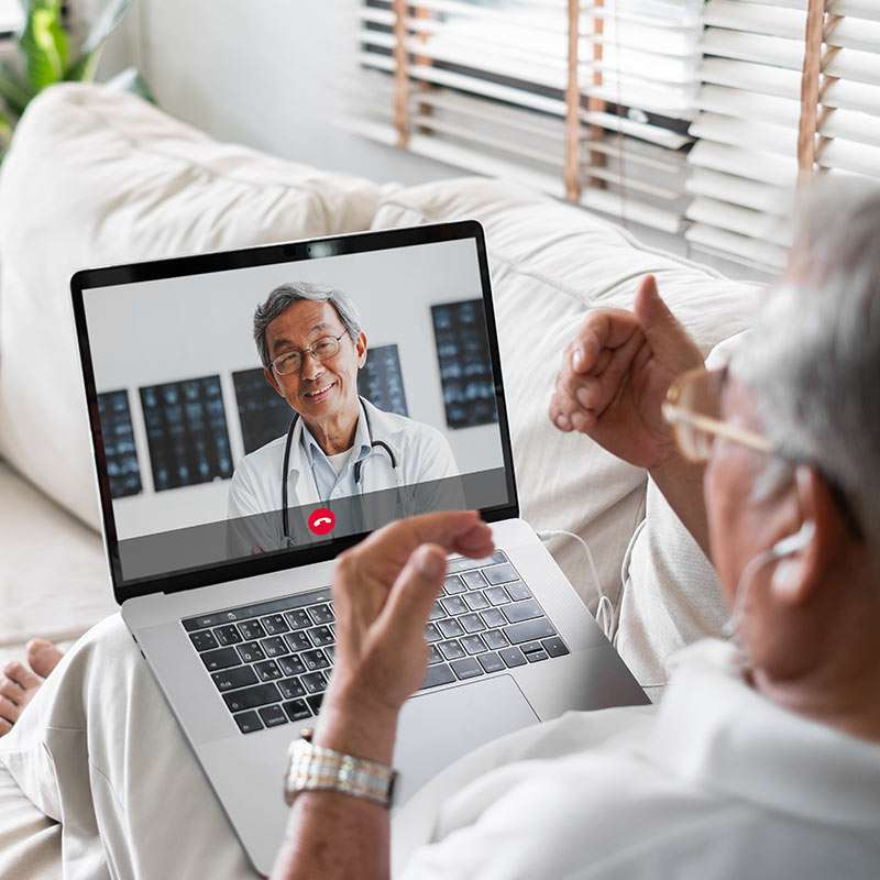 Man talking to his doctor on the computer during COVID-19